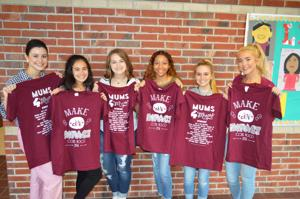 <p>Kelli Geise's advanced fashion class from Clear Creek High School pose with the Mums4Mums shirts.</p>