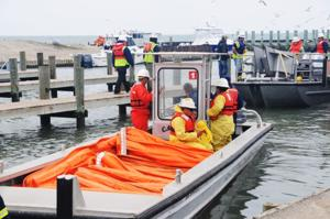 Oil spill cleanup ramps up