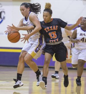 <p>Texas City's Tione Brooks tries to knock the ball away from Ball High's Nina Kovach during the second quarter at Ball High School in Galveston on Tuesday, Jan. 17, 2017.</p>