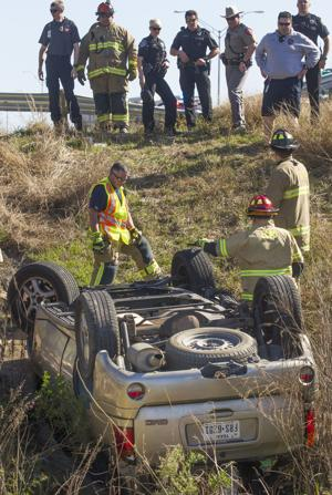 I-45 vehicle rollover results in minor injuries to driver
