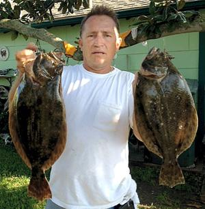 Angler shows off Pelican Island catch