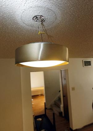 Beacon Place light fixture hangs by wires