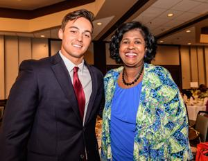 <p>Jacob Freeman, a graduate of Clear Springs High School, poses for a photo with Gail Love, a principal at Clear Springs High School, during the the Clear Lake Area Chamber of Commerce's welcome luncheon for new teachers in the Clear Creek school district at the South Shore Harbour Resort and Conference Center in League City.</p>