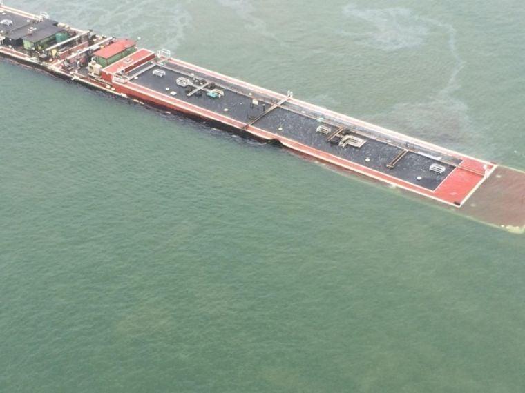 Barge leaks near Texas City Dike