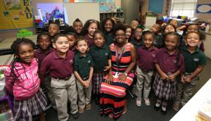 <p>Surrounded by her students, Mainland Preparatory Academy teacher Jennifer Washington is The Daily News' 2016 Teacher of the Year.</p>