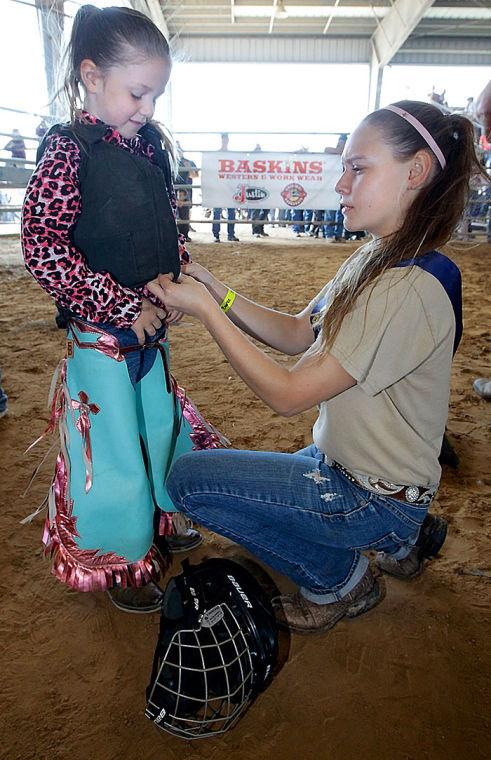 Girl gears up for a go in the Mutton Bustin' ring