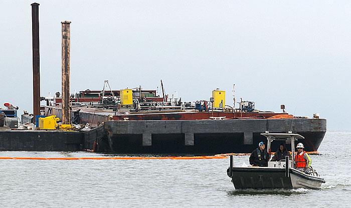 Crews work to repair disabled barge