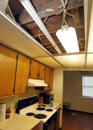 Ceiling, light fixtures broken, missing in Beacon Place unit