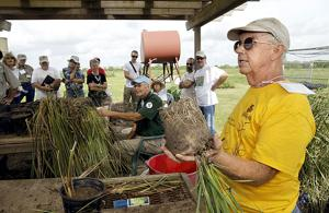 Group learns prairie restoration techniques during hands-on demonstrations
