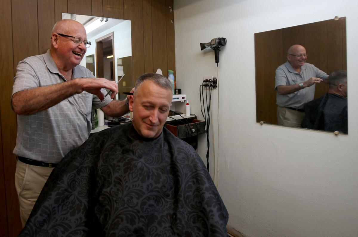 Barber retiring after 64 years