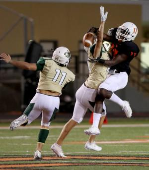 <p>Santa Fe defensive back Ethan Sonnier breaks up a pass intended for Texas City receiver Kenny Smith on Friday in the second quarter at Stingaree Stadium.</p>