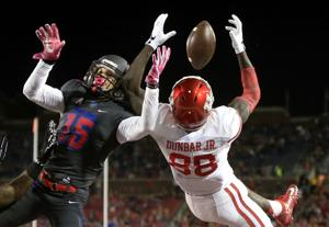 <p>Houston wide receiver Steven Dunbar (88) catches a touchdown pass next to SMU defensive back Jordan Wyatt during the first half Saturday, Oct. 22, 2016, in Dallas.</p>