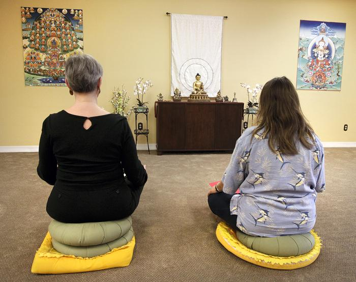 Meditating to reduce stress