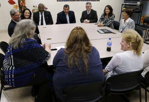 <p>New Jersey Gov. Chris Christie, background center, New Hope Baptist Church pastor Joe Carter, background center left, and former Gov. Jim McGreevey, background center right, listen as participants at an addiction and mental health treatment center talk about their experiences in Trenton, N.J. Christie has drawn accolades from supporters and detractors for his professed dedication to addressing the opiate problem in New Jersey and elsewhere. In reality, advocates and addicts say, he is helping those already in trouble with the law and failing those who are looking to get clean before they slip up and find themselves in jail.</p>