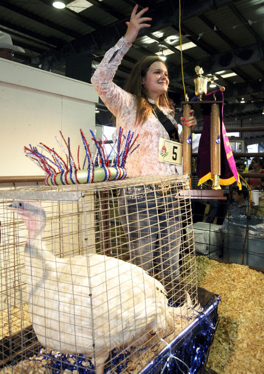 Girl calls for high bids for Grand Champion turkey