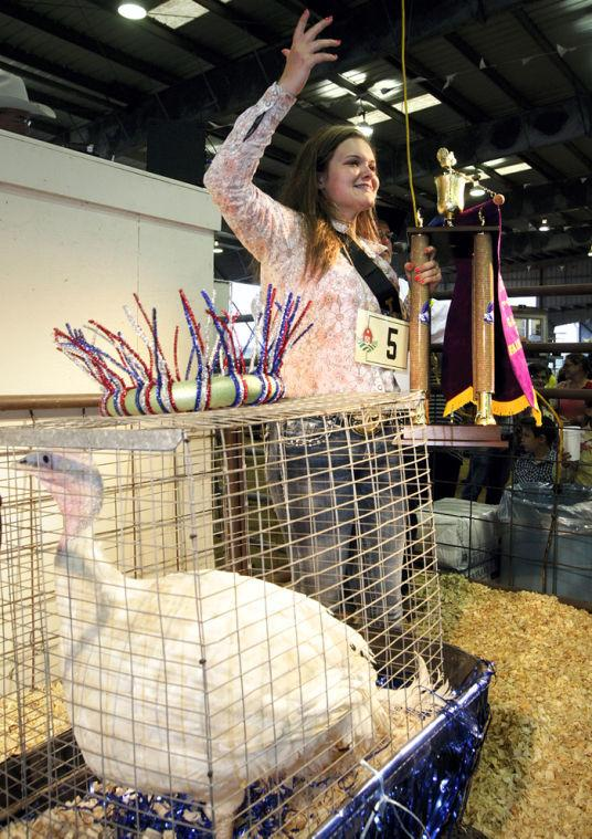 Girl calls for high bids for Grand Champion turkey