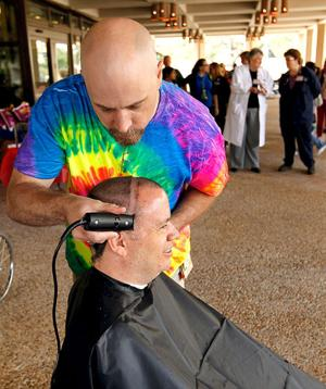 Dr. Keith Bly sells chances to shave head for The Rainbow Connection