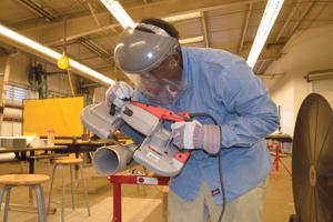 <p>Galveston College offers pipe fitting courses in its accredited National Center for Construction Education and Research training facility in the Charlie Thomas Family Applied Technology Center at 7626 Broadway in Galveston. Pictured, a pipe fitting student uses a special saw to trim the pipe in his class at the Center on Broadway.</p>