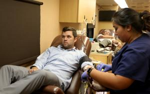 <p>Erica Montufar, with the Gulf Coast Regional Blood Center, checks on Travis Hassmann as he donates blood Monday, Aug. 29 2016, during a blood drive at ACU of Texas in League City. Since May, the Gulf Coast Blood Center has been screening donations for Zika, but a new recommendation from the Food and Drug Administration requires that all blood donated in the United States be tested for the virus.</p>