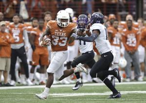<p>Texas running back D'Onta Foreman (33) is pursued by TCU safety Nick Orr on a 44-yard carry during the second half of a game Nov. 25 in Austin.</p>