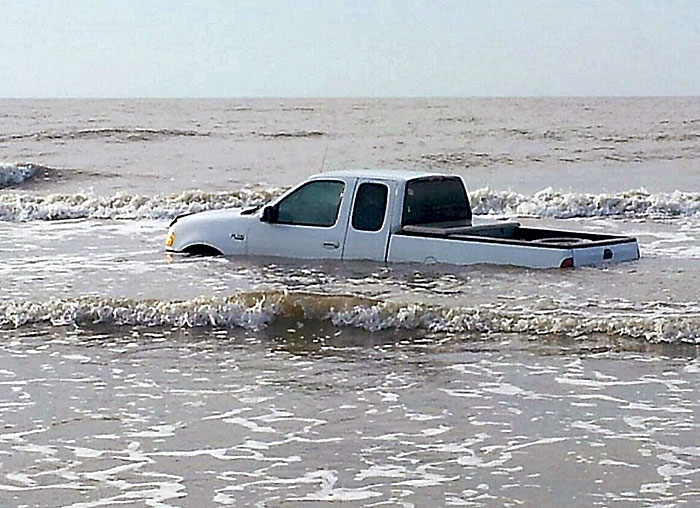 Truck abandoned in Bolivar surf