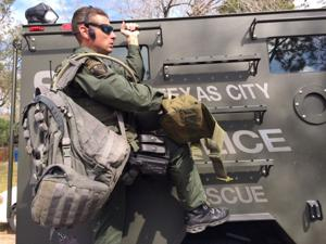 SWAT arrives as woman holds husband hostage