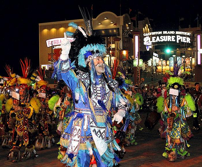 Mummers head down the seawall during Momus Grand Night Parade