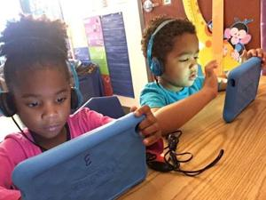 "<p>""I learn my ABC's and letter sounds,"" said Jace Turner, right, pictured here with Tramica Thomas.</p>"