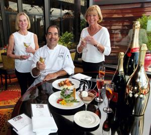 <p>Margo Markowitz, left, and Mary Ann Salch, with the PAWS gala committee, and Phil Bouza, executive chef at the San Luis Resort, are planning a James Bond themed night for the annual PAWS Gala on Sept. 12, 2015.</p>