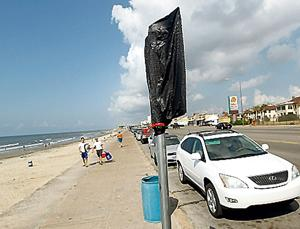 Parking signs going up along seawall, but isle mum on program start date