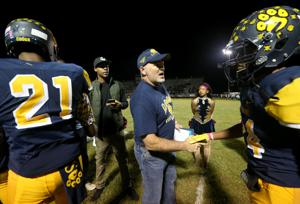 "<p>Former La Marque head football coach Bryan Erwin, who coached the 2003 and 2006 state championship teams, greets the Cougars as they take the field Friday, Oct. 21, 2016, for the second half of their game against the East Chambers Buccaneers at Etheredge Stadium in La Marque. Erwin's 2006 team, along with the 1986 and 1996 teams, were honored during the ""Night of Champions"" at halftime.</p>"