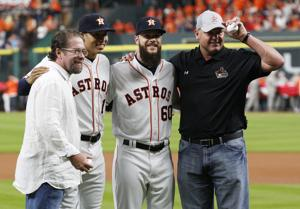<p>Former Astros Jeff Bagwell and Roger Clemens after throwing out the ceremonial first pitches to Carlos Correa and Dallas Keuchel before the Houston Astros home opener against the Kansas City Royals on Monday night April 11, 2016 at Minute Maid Park in Houston. The Astros defeated the Royals 8-2 before a sellout crowd of 43,332.</p>