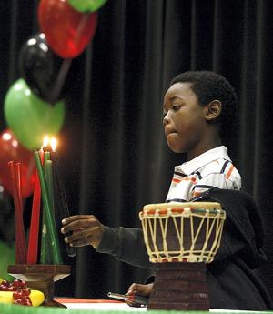 Marcus Simpson lights another Kwanzaa candle
