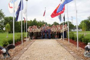 <p>George Rockett (center) was honored at his Eagle Scout Court of Honor on Aug. 21 in League City. He is joined by adults and scouts from Boy Scout Troop No. 9310 and Cub Scout Pack No. 603.</p>