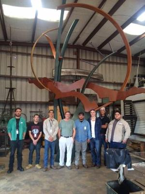 <p>Galveston College welding students stand in front of a landscape sculpture, designed and created by artist Doug McLean, of McLean Metal Works. From left to right are students Zachery Wintz, Rene Salazar, Humberto Salazar, welding artist Doug McLean, Juan Caballero, Eric Charalambous, TréShawn Watson and Welding Program Director, James Love.</p>
