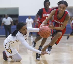 Swarming Hitchcock defense helps Lady Bulldogs run away from La Marque