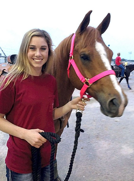 Parent and child duos compete in barrel racing