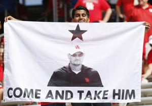 <p>A fan holds up a sign in support of keeping Houston Cougars head coach Tom Herman next season during the second quarter against the UCF Knights on Saturday afternoon Oct. 29, 2016 at TDECU Stadium in Houston. The Cougars came from behind to defeat Knights 31-24.</p>