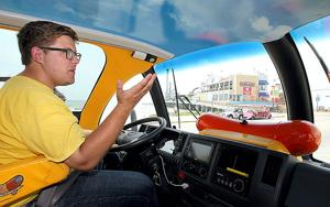 "<p>Matt Heng, whose title is ""Hotdogger"", cruises around Galveston behind the wheel of the Oscar Mayer Wienermobile on Thursday</p>"