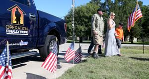 Veteran surprised with plans for new home in Santa Fe