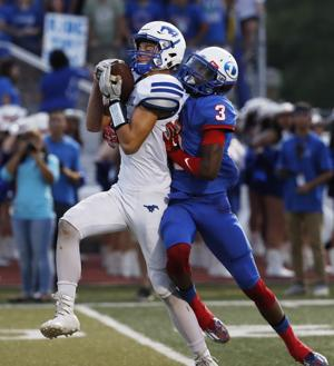 <p>Friendswood's Reid Nickerson intercepts a pass intended for Dickinson's Kaeleen Stelly during the first quarter on Friday night Sept. 23, 2016 at Sam Vitanza Stadium in Dickinson. The Gators defeated the Mustangs 21-16.</p>