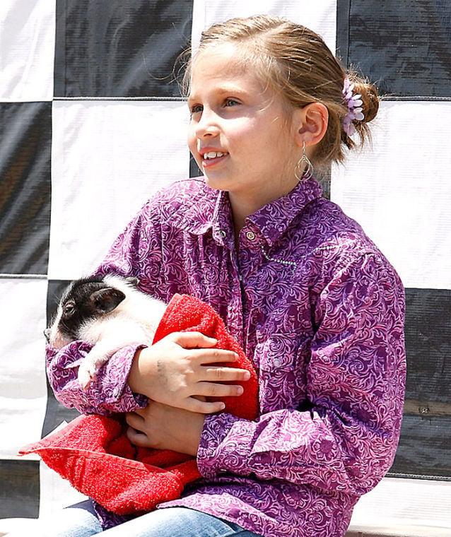 Girl poses with Swifty the Racing Swine