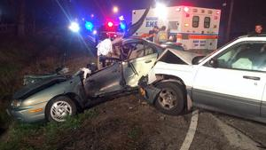 Woman injured in wreck
