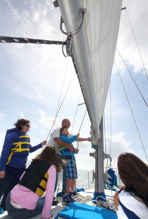 Captain and volunteers teach students with special needs to sail