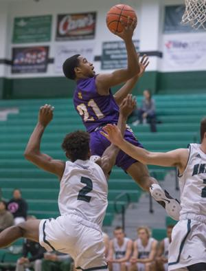 <p>Ball High School's Brian Ball glides to the hoop past Clear Falls' Dorian Mason during the second quarter at Clear Falls High School on Thursday.</p>