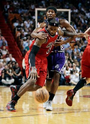 Heat win 12th straight, outlast Kings in 2OT