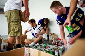 Football team collects food for Soup Kitchen