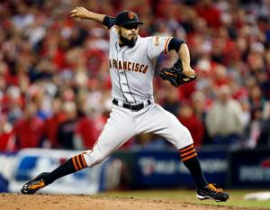 Giants beat Reds in 10th, cut NLDS deficit to 2-1