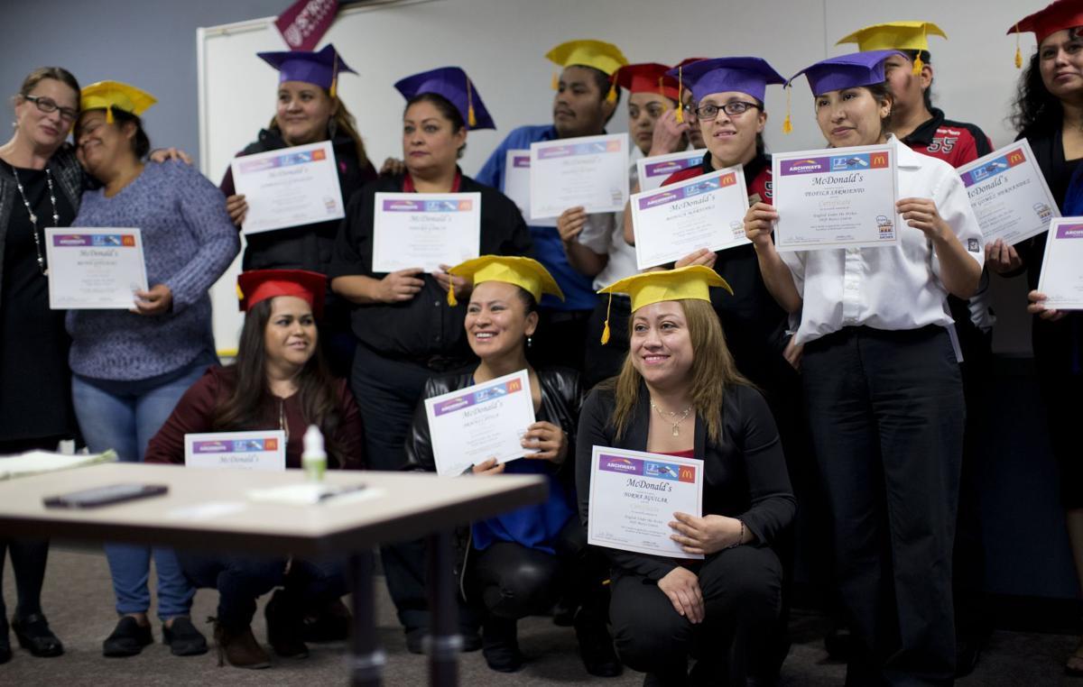 mcdonald s employees graduate from english language program life mcdonald s english under the arches graduation