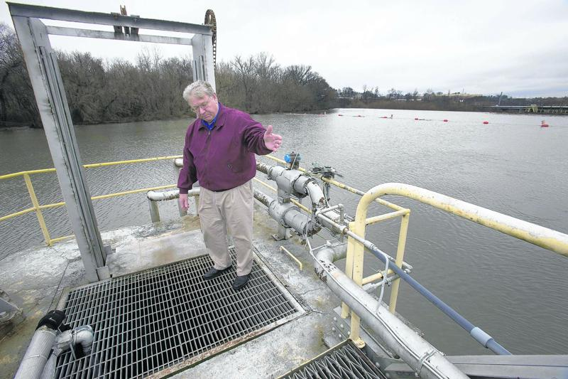 Barry Dunkley, the director of water and sewage treatment for Danville, Va., explains how two 24-inch pipes draw raw water from the Dan River into the treatment plant for the city's water supply.